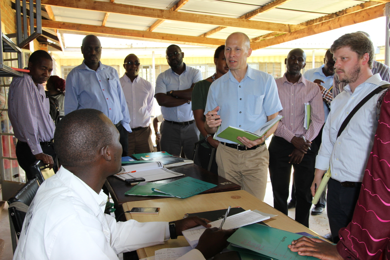 Sean Cavanaugh from the US Department of State interacts with a Bondo Sub-County Hospital HTS Provider on HIV testing and Partner Notification Services offered in the facility.