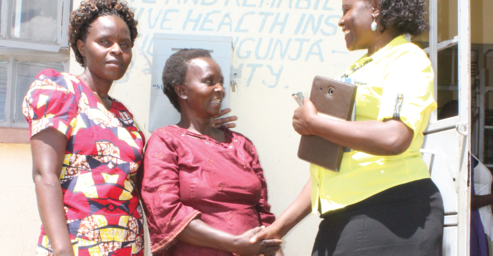 Margaret (centre) greets Siaya County TB and Leprosy Coordinator Mary (right) as CHV Rosemary looks on